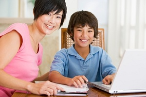 parent and child using a traditional homeschooling curriculum